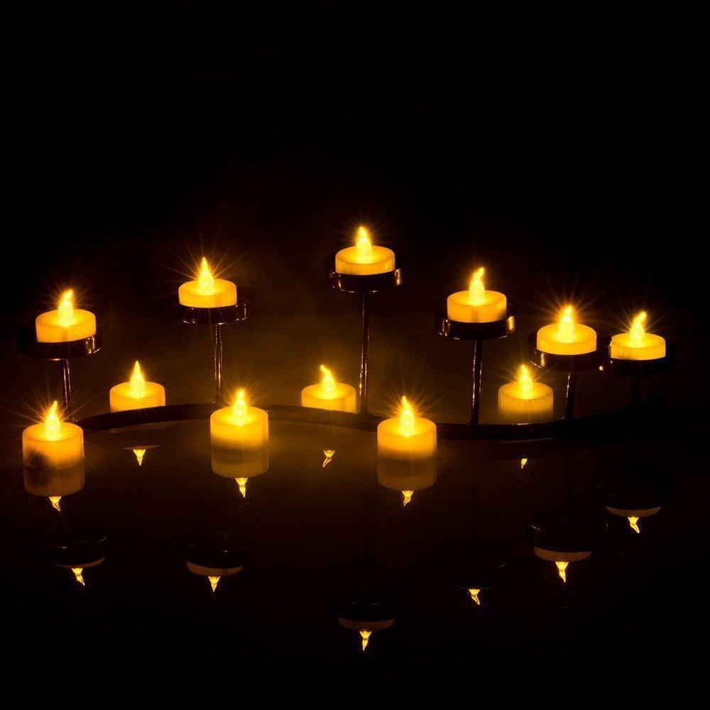 12x electronic battery led fake candles tea lights flickering wedding party xmas ebay. Black Bedroom Furniture Sets. Home Design Ideas